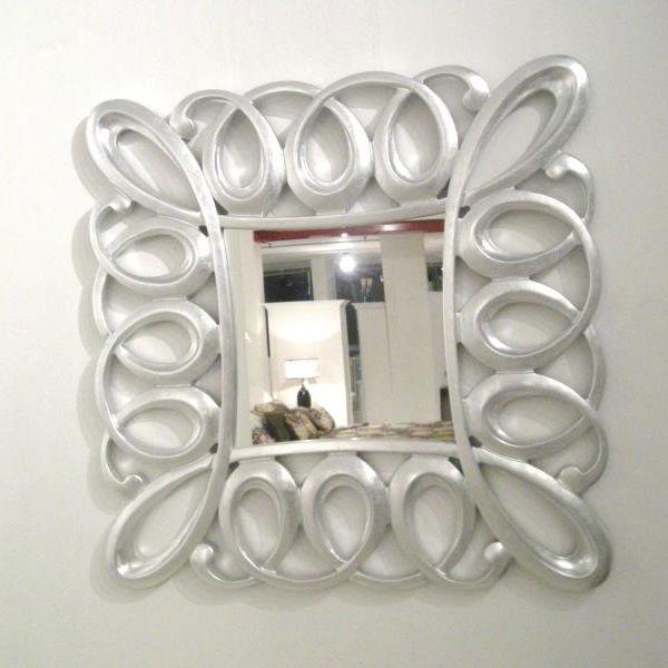 Cornice specchiera in massello di abete finito in foglia argento